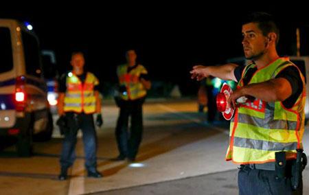 Réfugiés: Paris et Berlin veulent des contrôles aux frontières de l'UE.