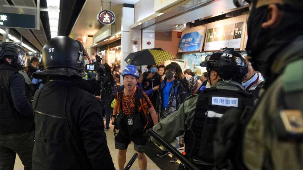 Hong Kong: accalmie rompue par des affrontements dans des centres commerciaux