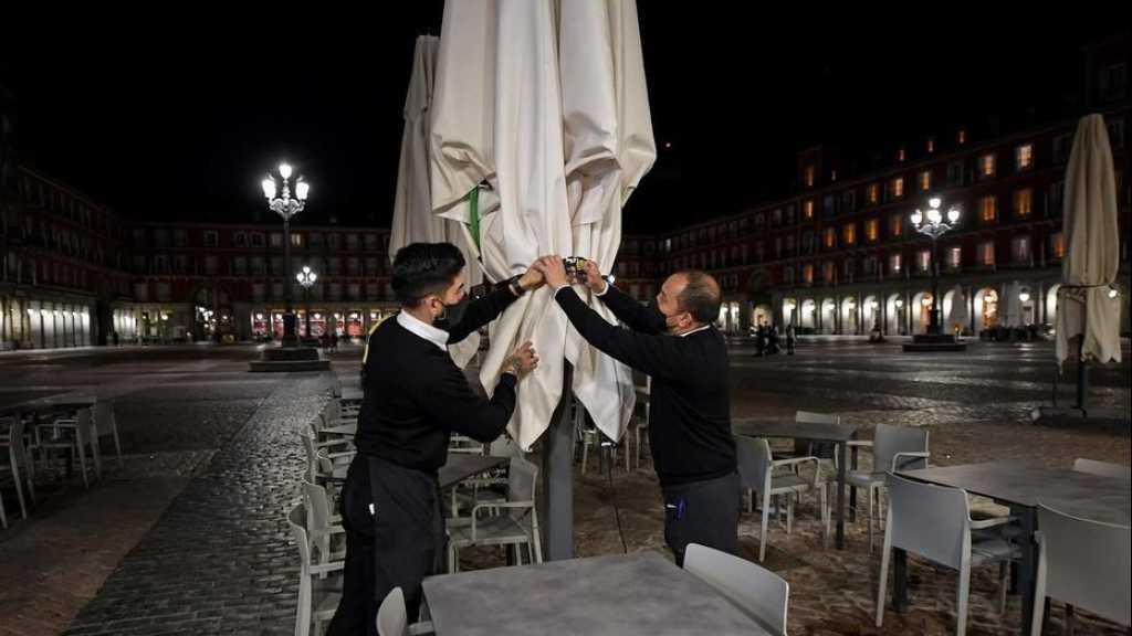 Coronavirus: nouveau record mondial de cas, couvre-feu en Italie et en Espagne