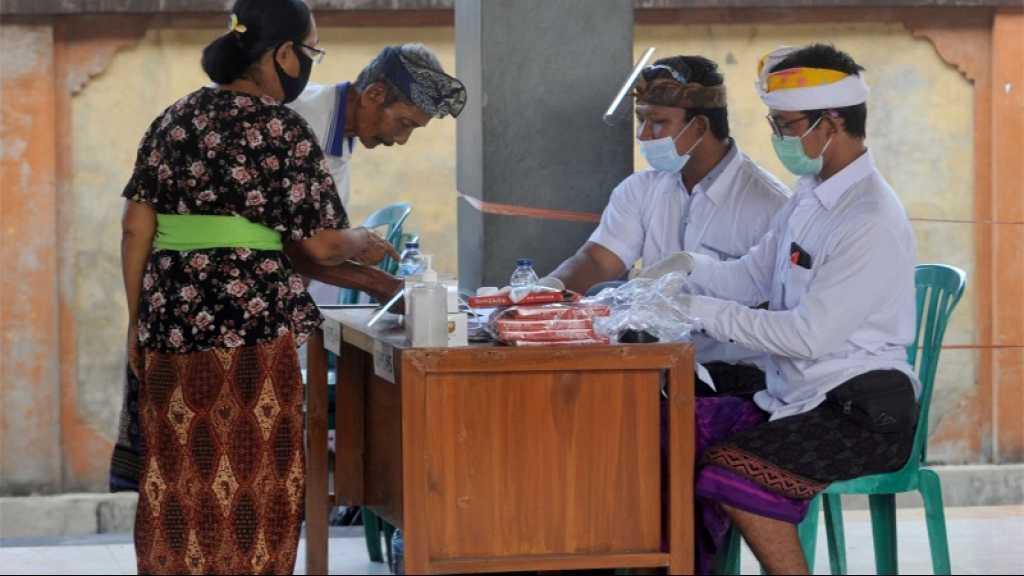 Les Indonésiens votent malgré les craintes d'une accélération de l'épidémie de Covid-19