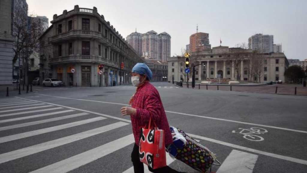 Coronavirus: les USA accélèrent leur lutte contre la pandémie, Pékin se reconfine en partie