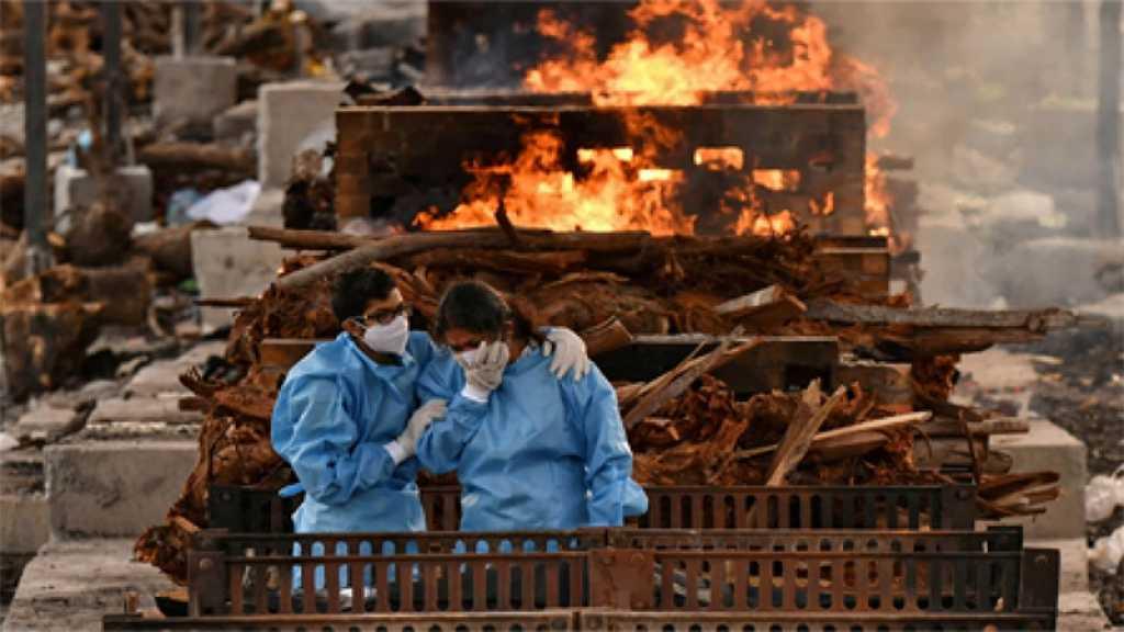 Coronavirus: cap des 300.000 morts franchi en Inde, le monde «en guerre» contre la pandémie