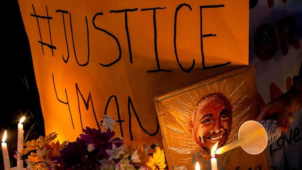 États-Unis: trois policiers inculpés pour avoir asphyxié un Afro-Américain