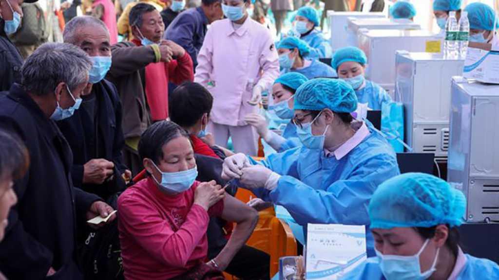 Covid-19: un milliard de doses de vaccins administrées en Chine, assouplissements en France et au Japon